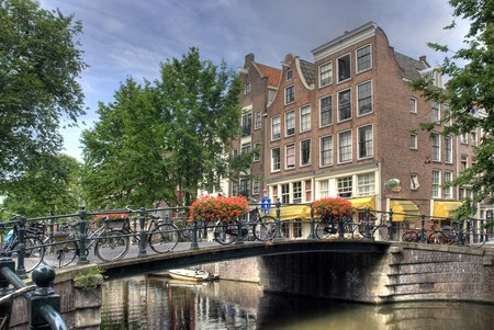 Bridge with flowers over Amsterdam canal Stock Photo - 7746830