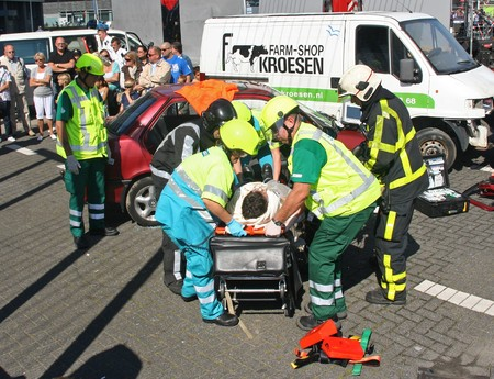 medical personnel: ROTTERDAM, HOLLAND - SEPTEMBER 5, 2010: Demonstration of handling of car crash victim by medics at the annual World Harbor Days in Rotterdam, Holland on September 5