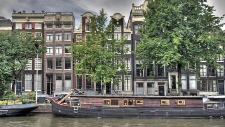 canal house: Canale di Amsterdam, casa barca e case Archivio Fotografico