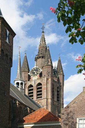 delft: Church tower of Delft, Holland, with flowers Stock Photo