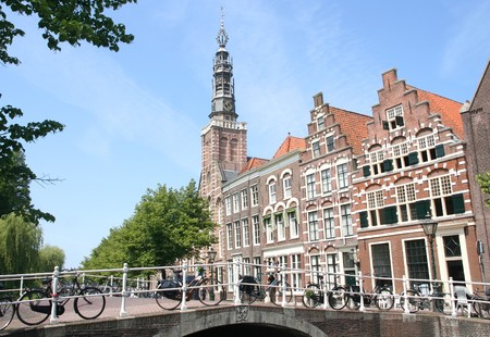 Old bridge, church and historic houses in Leiden, Holland photo