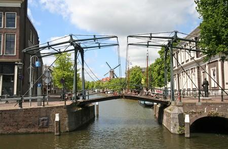 schiedam: Historic draw bridge and windmill in Schiedam, Holland Stock Photo