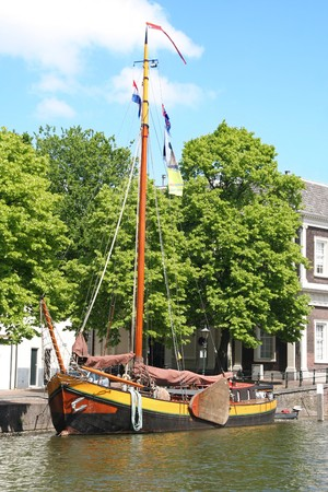 schiedam: Historic sailboat in Schiedam canal, Holland