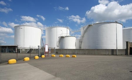 Large oil silo's along the road in Rotterdam harbor area Stock Photo - 7878380