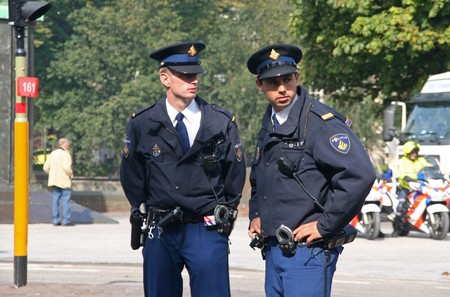 THE HAGUE, HOLLAND - SEPTEMBER 21, 2010: Young police officers watching the crowd at the Parliament on Prinsjesdag (annual presentation of Government Policy to Parliament by the Queen) in The Hague, Holland on september 21 Stock Photo - 7960836