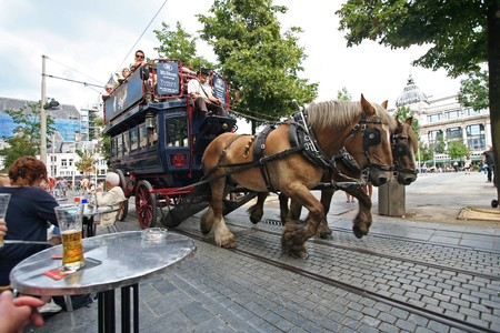 Horse driven historical Tourist Coach in Antwerp, Belgium on August 14, 2010