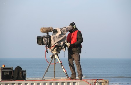 TV camera man filming at Red Bull motorcross race in Scheveningen, Holland on November 18, 2007 報道画像
