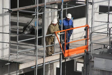 Foremen at a construction site in The Hague on February 16, 2007 Stock Photo - 8150717