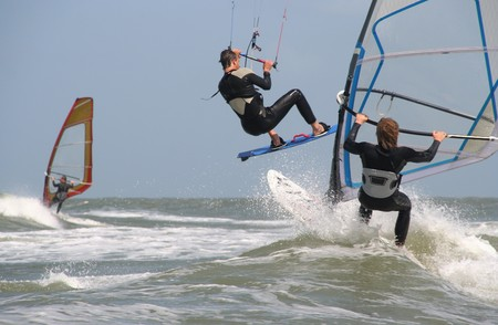 wind surfing: Wind surfers and kite surfers at Scheveningen beach on May 19, 2007 Editorial