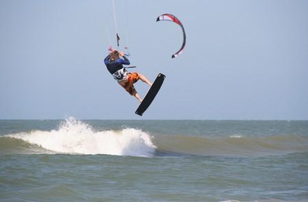 Kite surfer jumping at Scheveningen beach on July 7, 2007