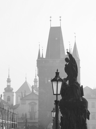 Prague Charles Bridge and statues in black and white photo