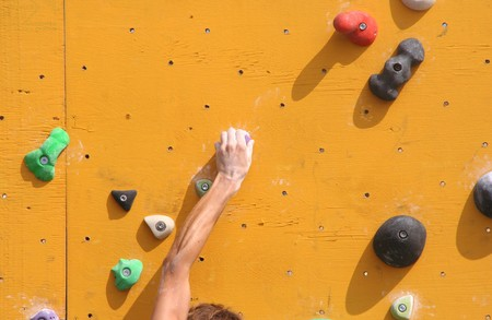 bouldering: Hand of a climber on a bouldering wall