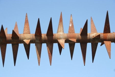 Rusty spikes on a fence Stock Photo - 8174910