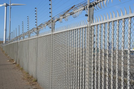 High security fence around industrial area photo