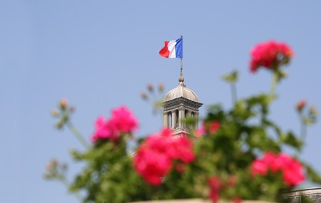 French flag on top of the Luxembourg Palace in Paris photo
