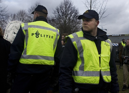 Politie op student demonstratie tegen bezuinigingen op de overheidsuitgaven aan onderwijs. Foto genomen op 21 januari 2011 in Den Haag, Nederland Redactioneel