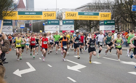 THE HAGUE, HOLLAND - MARCH 13, 2011: Runners at the start of the half marathon of The Hague, Holland on March 13, 2011
