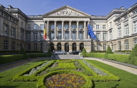 frontyard: The Belgian parliament in Brussels, Belgium, with the Belgian and the European Union flag Stock Photo