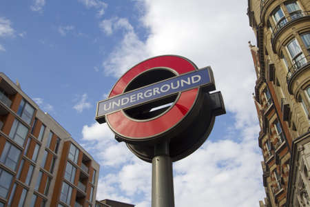 knightsbridge: Sign of the London subway along Knightsbridge in Kensington on July 22, 2011 in London, UK.