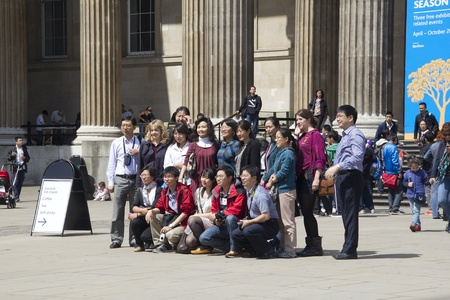 London, UK - July 23, 2011: Asian tourists make a group portrait at the entrance of the British Museum in London, UK on July 23, 2011.