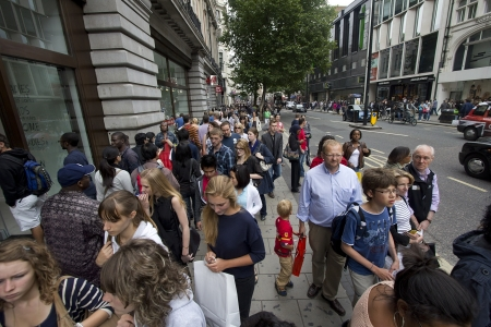 London, UK - July 23, 2011: People walking on the sidewalk of Oxford Street in London, UK on July 23, 2011.