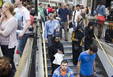 London, UK - July 23, 2011: People of different ethnic backgrounds taking the subway at Oxford Circus Station in London, UK on July 23, 2011.