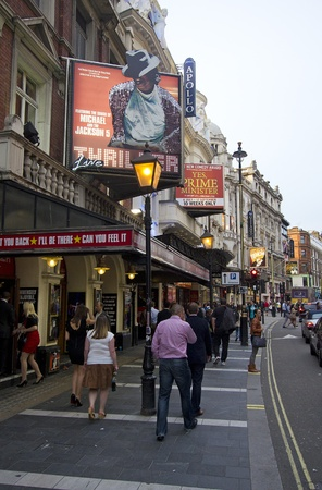 London, UK - July 23, 2011: People walking past theaters on Shaftesbury Avenue in the evening in Soho, London, UK on July 23, 2011. Stock Photo - 11025876