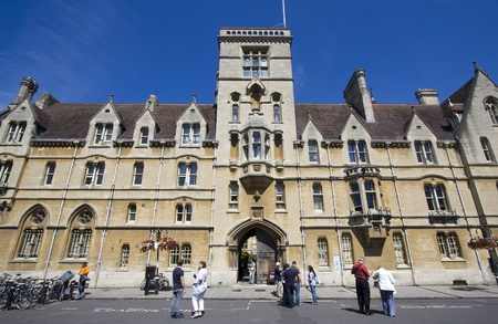 Oxford, UK - July 24, 2011: Tourists stand in front of Balliol College in Oxford, UK on July 24, 2011. Stock Photo - 11025913
