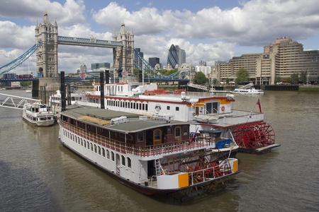 LONDON, UK - JULY 22: Old river boats moored in front of Tower Bridge on July 22, 2011 in London, UK.