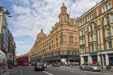 LONDON, UK - JULY 22: Harrods Department Store and traffic along Knightsbridge in Kensington on July 22, 2011 in London, UK.