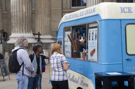 british museum: London, UK - July 23, 2011: People buy ice cream at the entrance of the British Museum in London, UK on July 23, 2011.