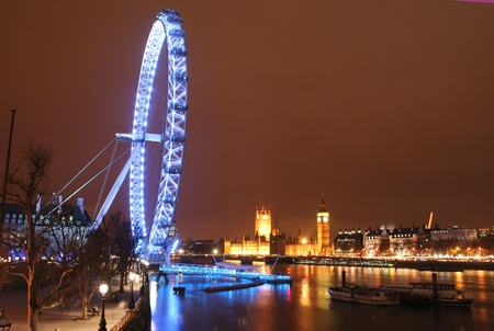London, United Kingdom - December 27, 2007: The London Eye, the Thames and Westminster at night