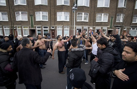 flagellation: THE HAGUE, HOLLAND - DECEMBER 5: Shiite muslims practice self-flagellation in the parade of the Ashura festival on December 5, 2011 in The Hague, Holland Editorial