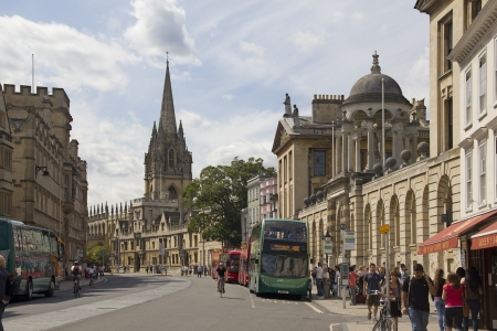 oxford: Oxford, UK - July 24, 2011: Tourists walking in Broadstreet in Oxford, UK