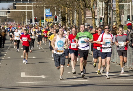 cpc: The Hague, Holland - March 11, 2012: Large group of runners in the CPC CIty Pier City Race in The Hague, Holland