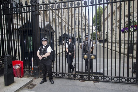 London, UK - July 25, 2011: Guards secure the entrance to British government buildings on July 25, 2011 in London, UK