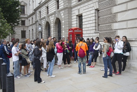 London, UK - July 26, 2011: Tourists listen to their tourguide near Westminster Parliament on July 26, 2011 in London, UK Stock Photo - 13257376