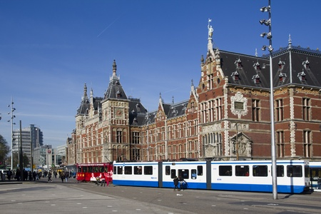 trams: Amsterdam, Holland - October 14: Trams waiting at Amsterdam Central Station