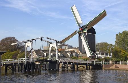 Drawbridge and windmill in Leiden, Holland photo