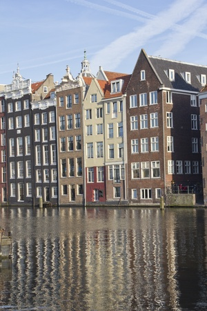 Historical houses along an Amsterdam canal in Holland photo