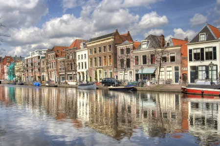 Historical houses along a canal in Leiden, Holland