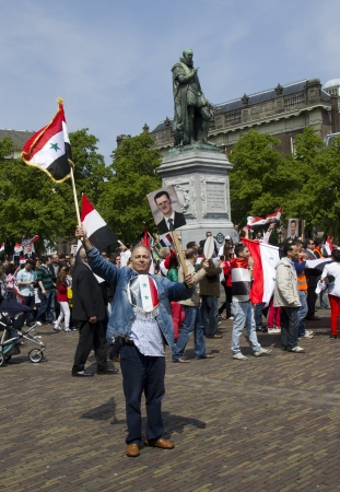 assad: THE HAGUE, HOLLAND - MAY 19: Syrians demonstrate for Syria and Assad in the center of The Hague, Holland on May 19, 2012