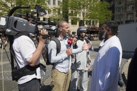 fundamentalism: AMSTERDAM, HOLLAND - MAY 25: British Muslim fundamentalist Anjem Choudary talks to the press on his visit to Amsterdam, Holland on May 25, 2012 Editorial