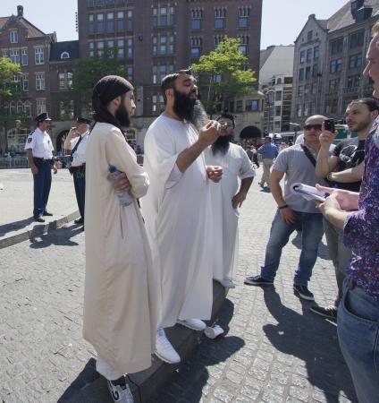 fundamentalism: AMSTERDAM, HOLLAND - MAY 25: British Muslim fundamentalist Sayful Islam talks to the press on his visit with Anjem Choudary to Amsterdam, Holland on May 25, 2012