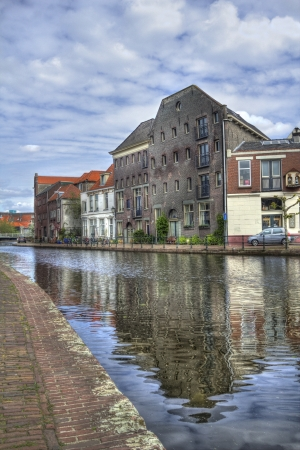 schiedam: Canal, quay and old warehouses in Schiedam, Holland Stock Photo