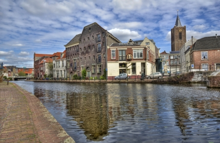 schiedam: Canal and historical houses with their reflections in the water in Schiedam, Holland