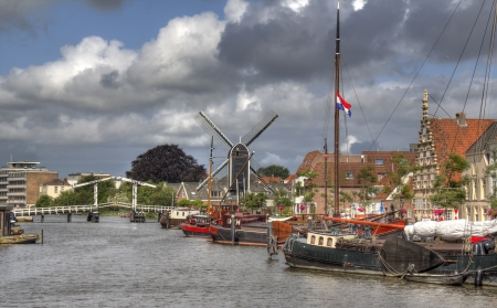 Canal with boats inLeiden, Holland photo