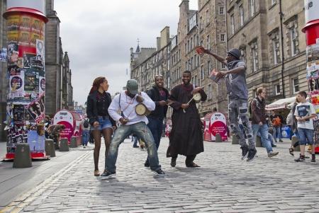 EDINBURGH, UK: AUGUST 2: Unidentified group of black people perform on the street at the Edinburgh Festival Fringe in Edinburgh, UK on August 2, 2012