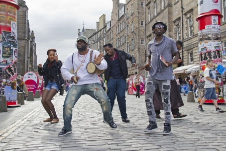 EDINBURGH, UK: AUGUST 2: Unidentified group of black people perform on the street at the Edinburgh Festival Fringe in Edinburgh, UK on August 2, 2012