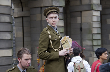 EDINBURGH, UK: AUGUST 2: Unidentified actor of Macbeth by As Told By Productions hands out flyers on the street at the Edinburgh Festival Fringe in Edinburgh, UK on August 2, 2012